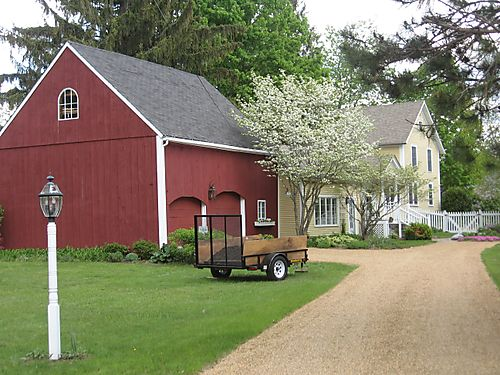 Yellow House with Red Barn